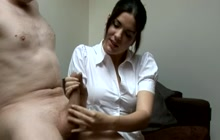 Girl In Clothes Gives Hand Job