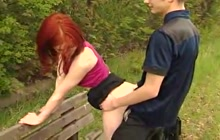 Redhead Cutie Fucked On A Bench In The Park