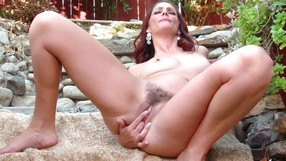 Cougar Fingers Her Tight Hairy Pussy Outdoors