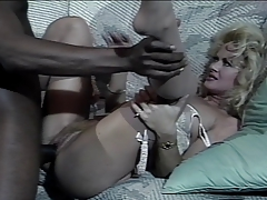 Slutty Blonde And Ebony Fellow Are Having Interracial Sex