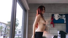 Sexy Redhead Stripping In Front Of The Camera