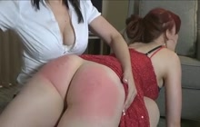 Redhead And Brunette Spank Each Other
